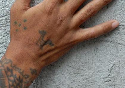 Five dots tattoo on hand