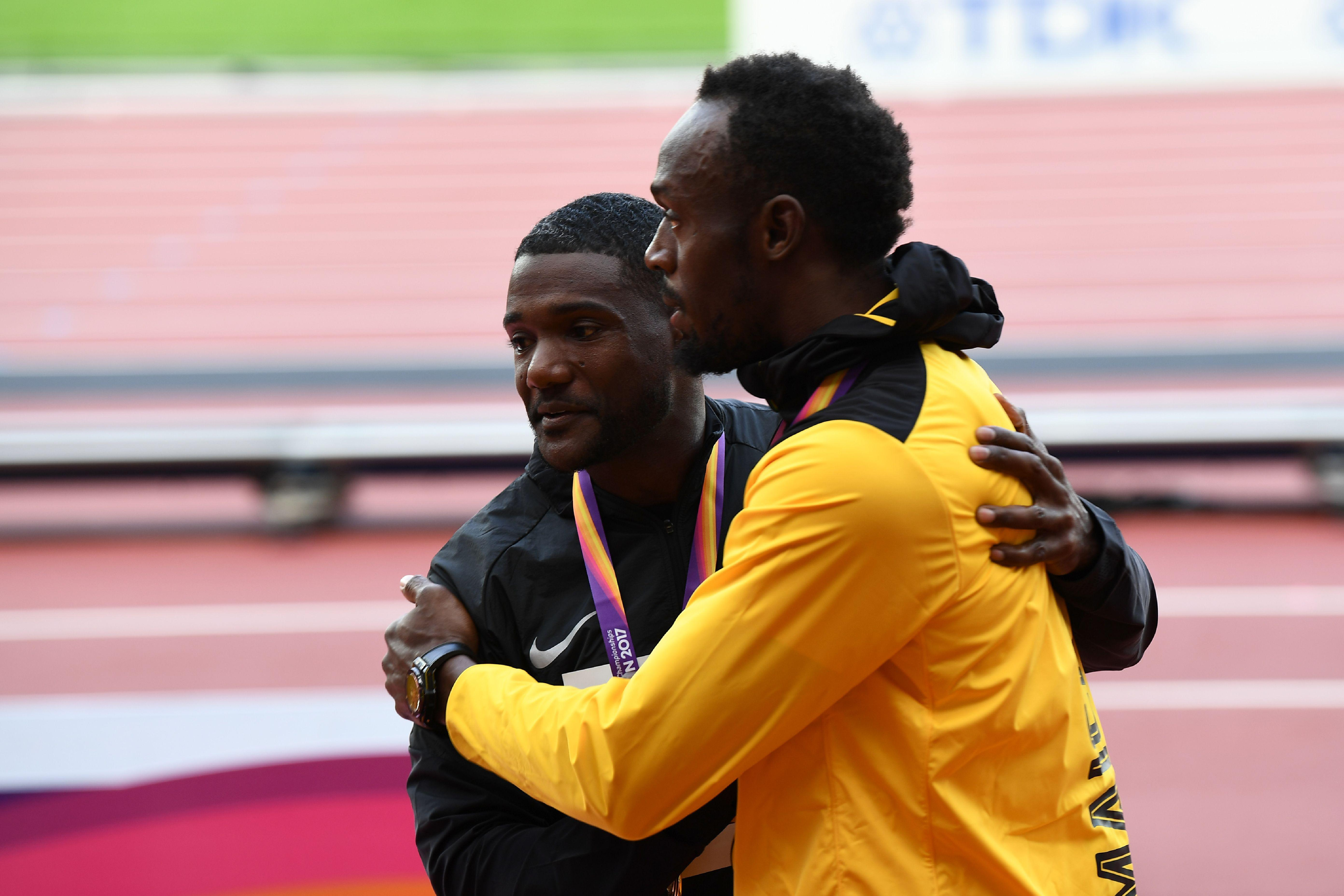 Usain Bolt and Justin Gatlin embrace each other after receiving their medals