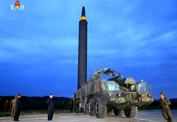 The despot was pictured inspecting the missile prior to its launch early on Tuesday morning