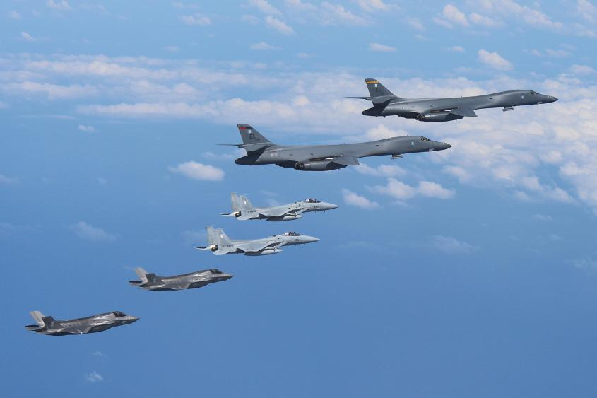 Two B-1Bs fly from Guam with an escort of a pair of Japanese F-15s and US Marines' F-35B fighter jets