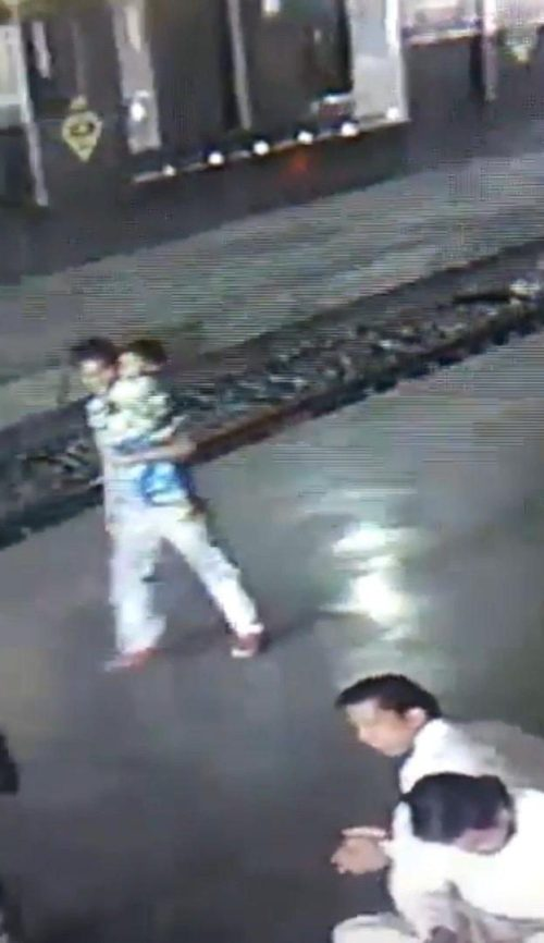 The boys mum was buying food when the suspect carried him away from the train station