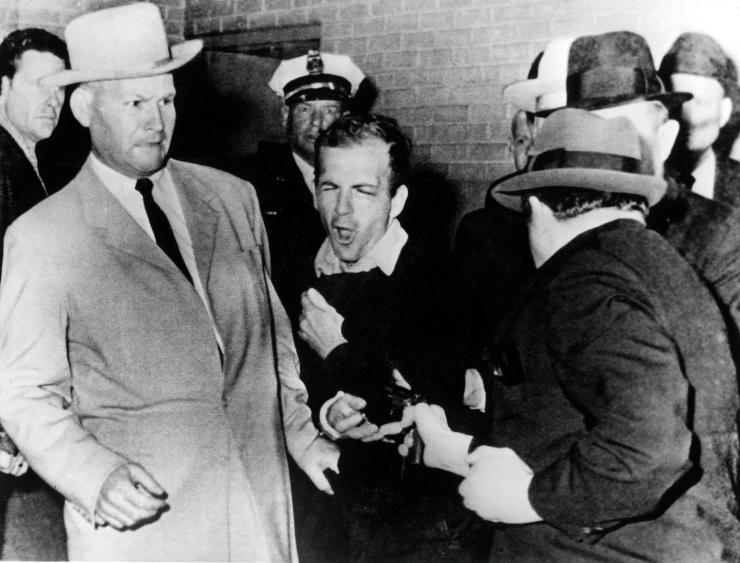 Lee Harvey Oswald is shot at point blank range by Dallas night club owner Jack Ruby