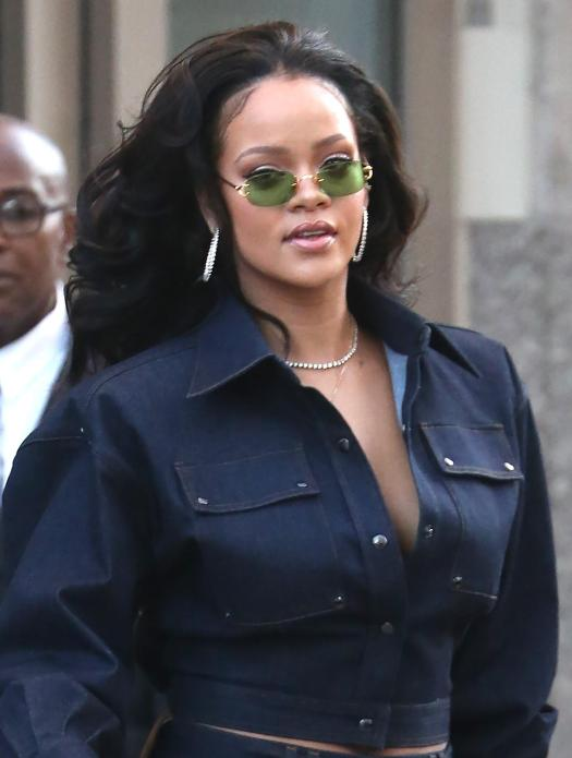 The busty star gave a hint of cleavage in a denim Tom Ford blouse
