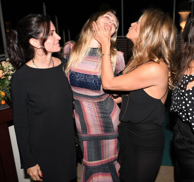 Jennifer was particularly playful as she placed a hand on her friend's cheek and puckered up