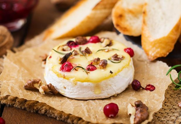Add cloves of garlic into your camembert to make it even more tasty
