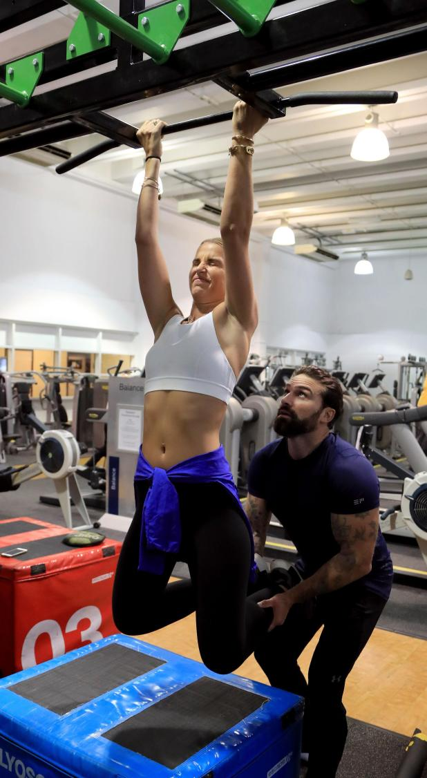 Vogue was helped by Ant as she completed a pull up exercise