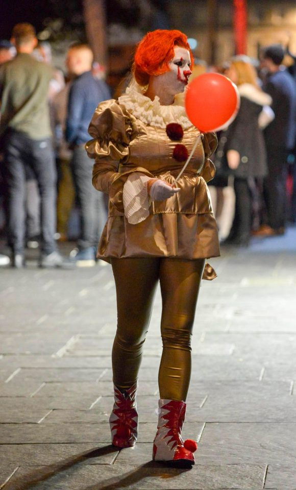 An inventive Halloween fan pulled off the Pennywise clown, complete with a red balloon