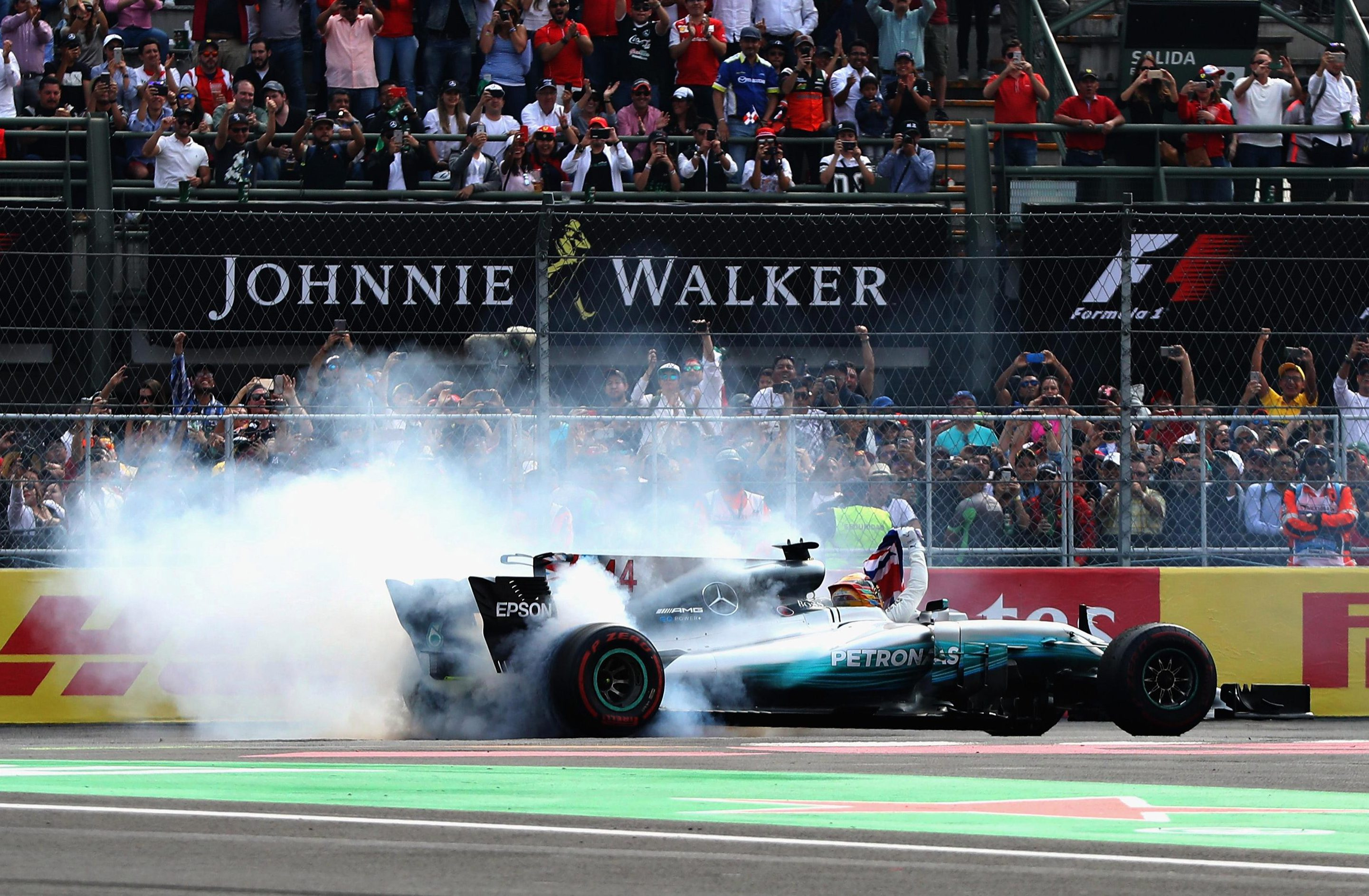 Lewis Hamilton celebrates his drivers' championship win by performing a donut