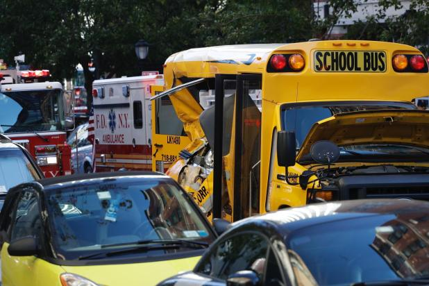 The truck smashed into a school bus before it came to a stop and the attacker fled on foot