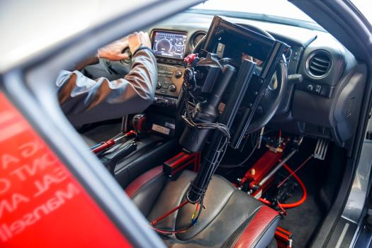 Supercar cockpit uses four robots hooked up to wifi