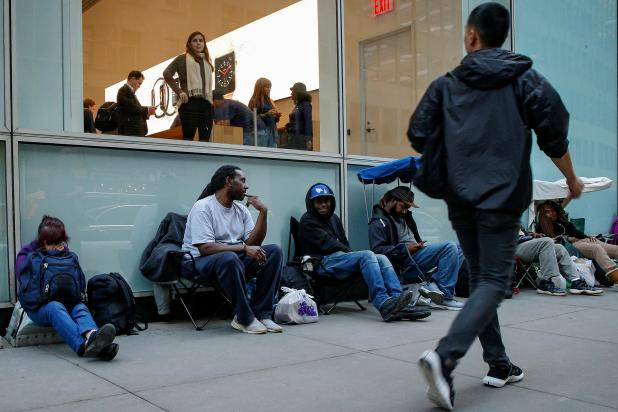 Customers wait in line for the new iPhone X in New York