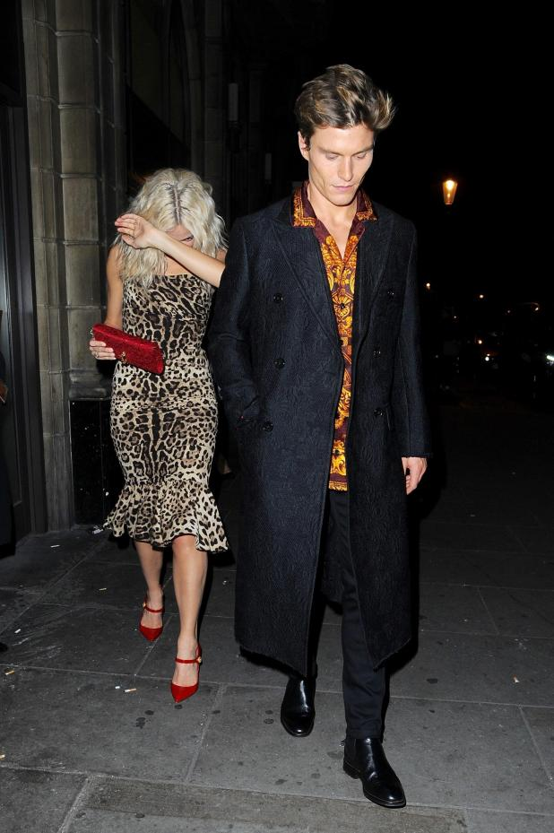 Pixie Lott hid from the cameras while dressed in a leopard print midi dress