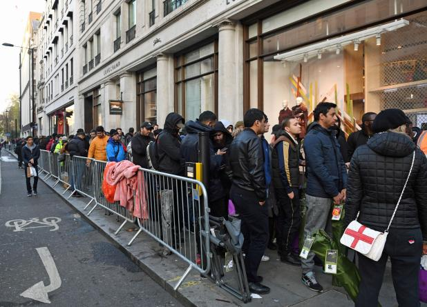 People queuing outside the Apple Store on Regent Street, London, as the iPhone X goes on-sale in the UK