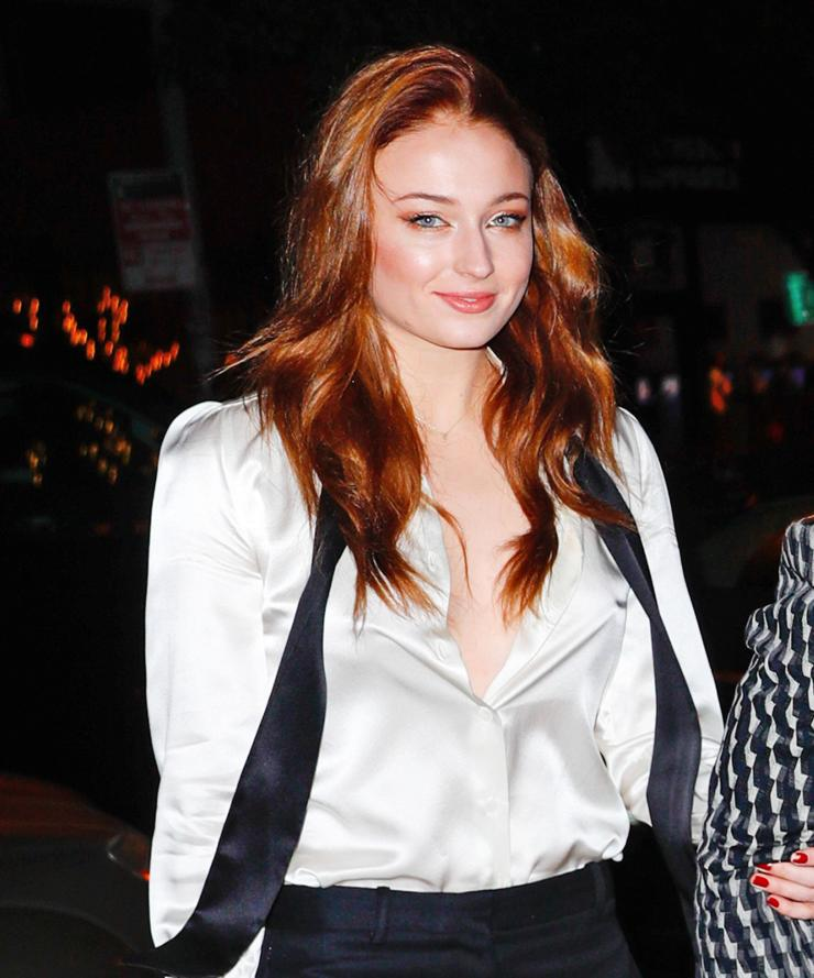 The red-head looked stunning in a button-down blouse with her red locks loose