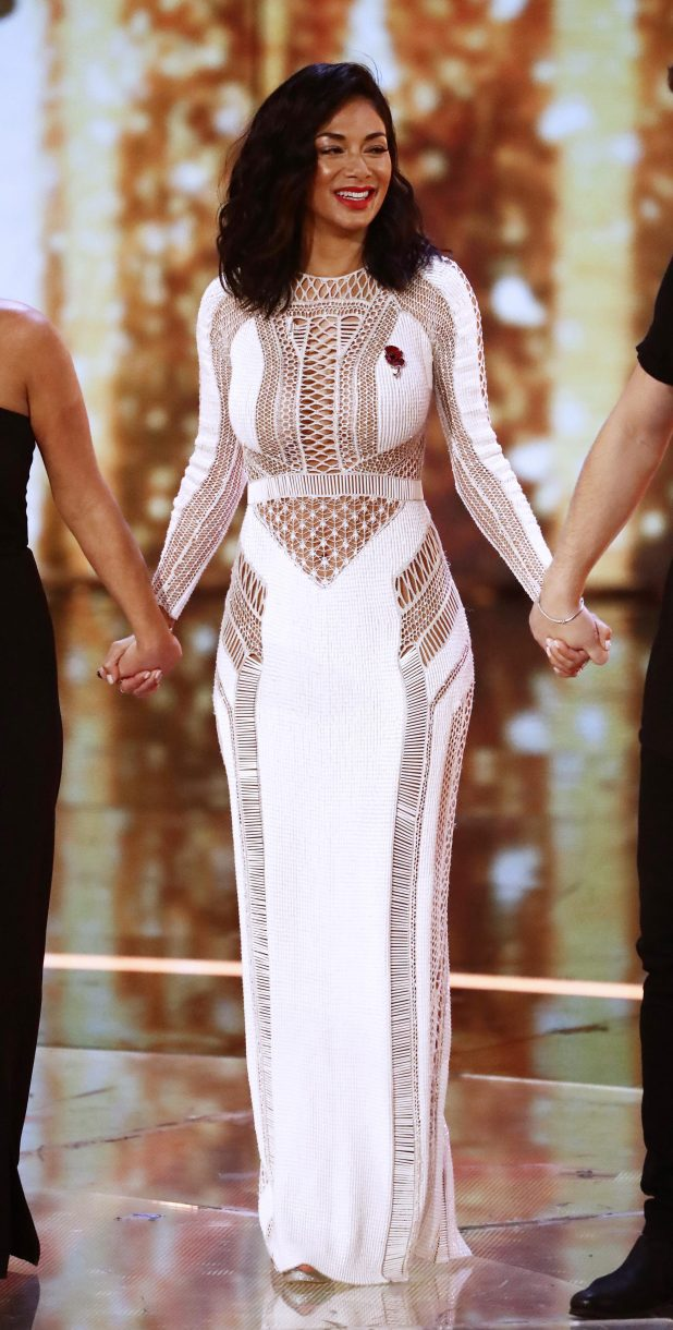 Nicole looked sensational in a white floor length dress with crochet and lace panelling