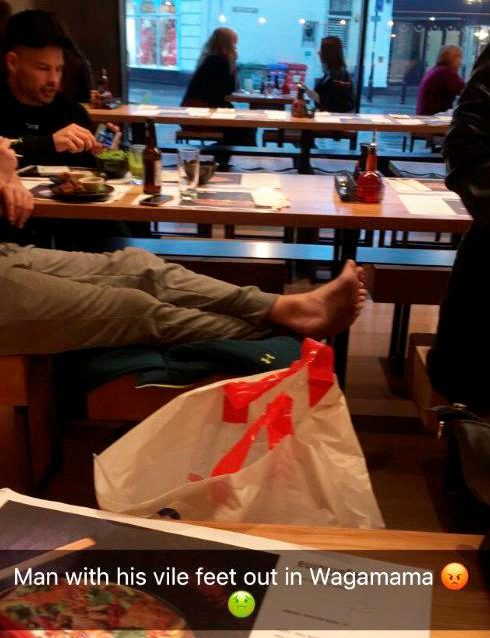 Saffron Snow took this picture of a diner with his bare feet on the seats in Wagamama