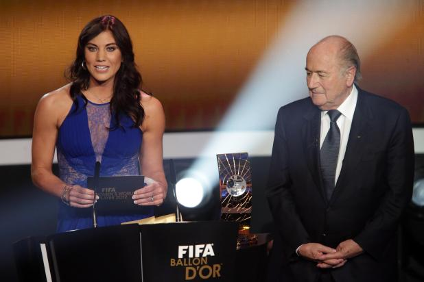 Hope Solo and Sepp Blatter on stage together at the Ballon d'Or awards in 2013