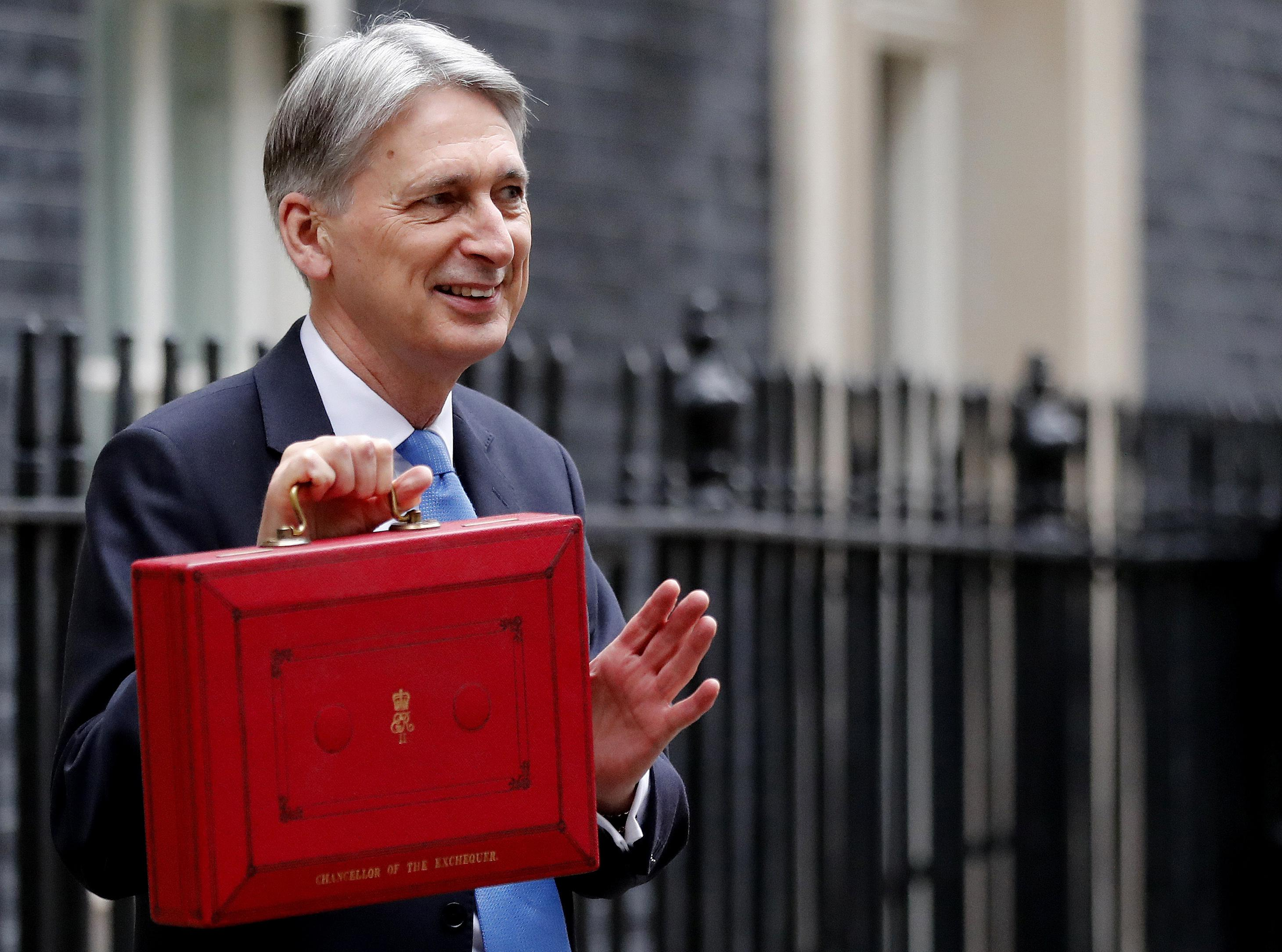 pressure mounts philip hammond freeze insurance tax 2