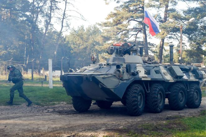 A BTR-80 amphibious armoured vehicle takes part in an exercise in September