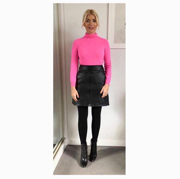 Holly paired her cashmere jumper and leather skirt with Topshop boots
