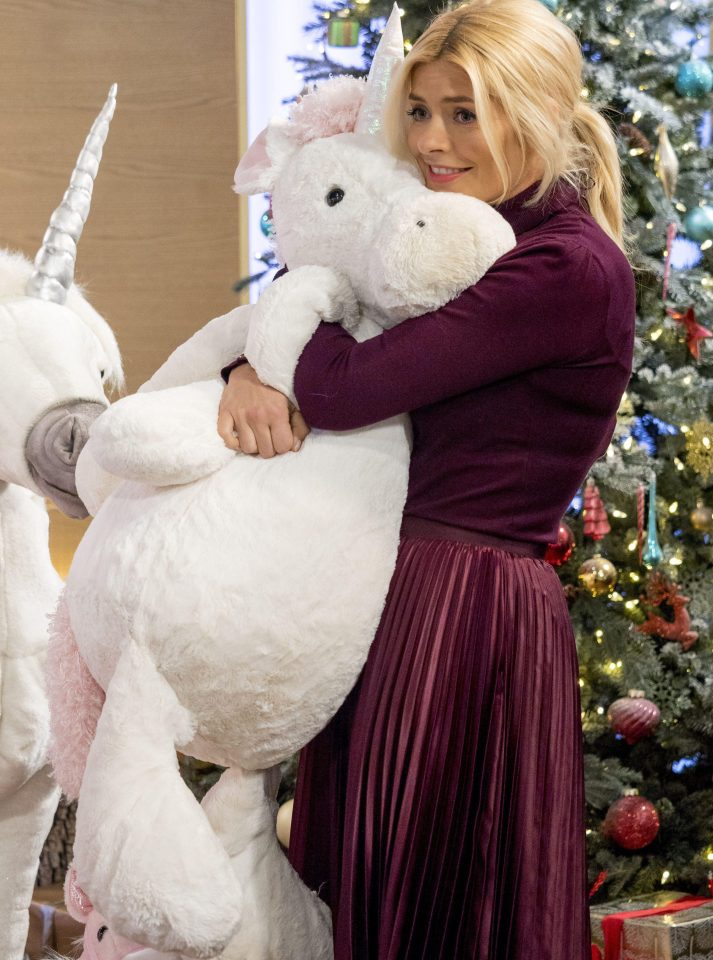 The star snuggled up to the cuddly toys during today's show