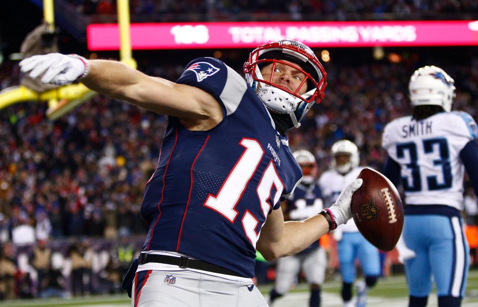 Chris Hogan throws the ball into the stands after scoring in the first half