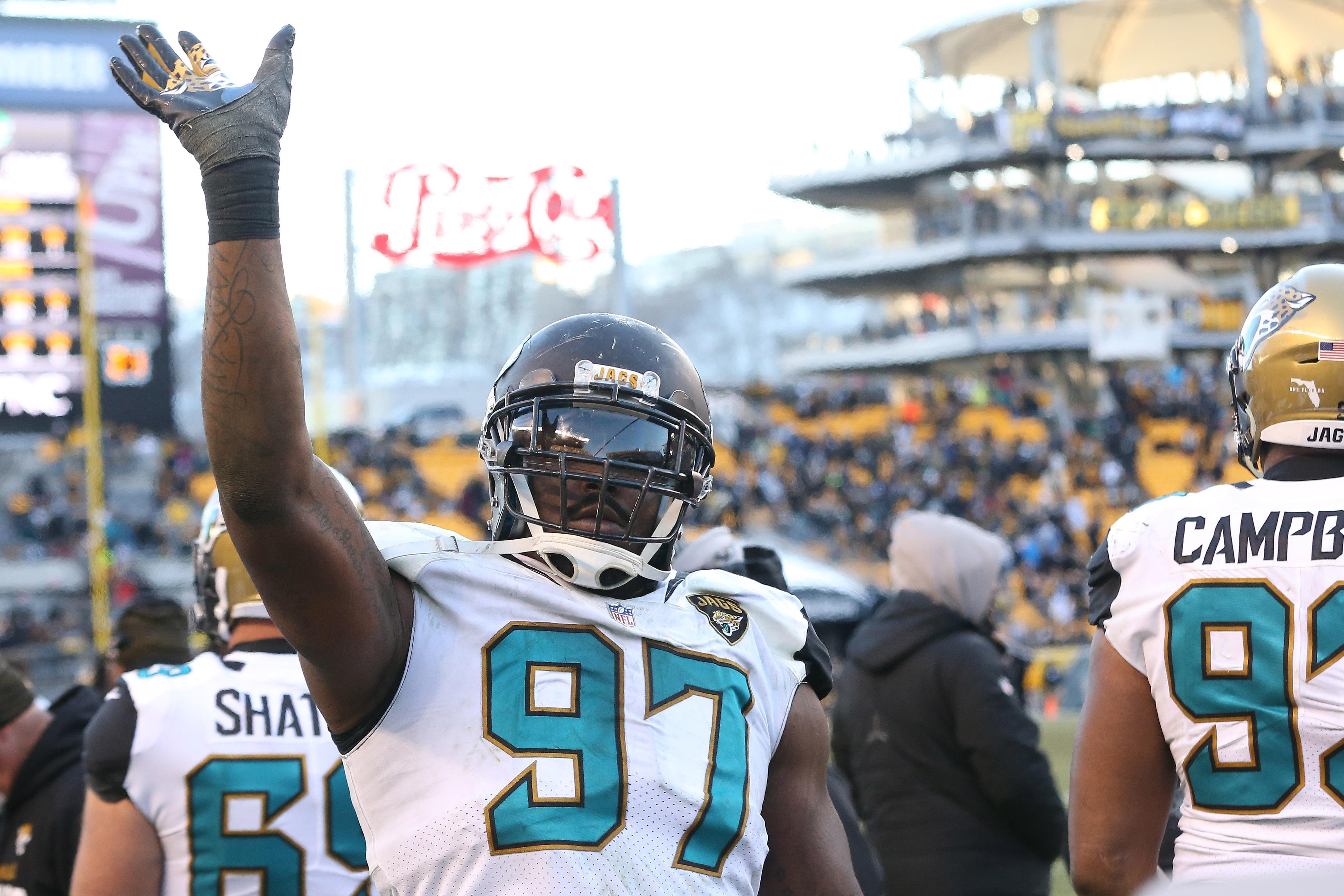 Jacksonville defensive lineman Malik Jackson waves to Pittsburgh fans after Jacksonville's win