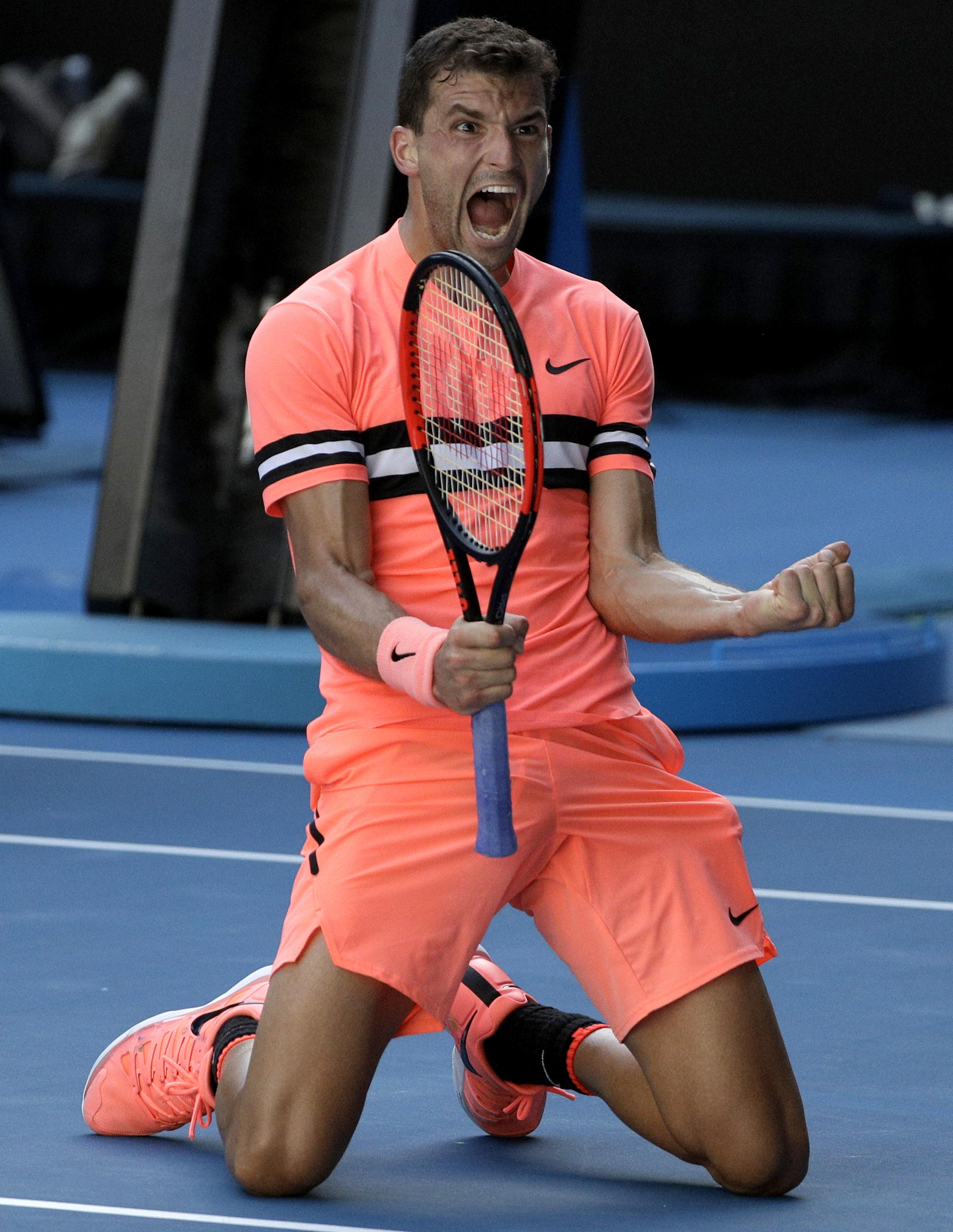 Grigor Dimitrov celebrates after defeating Russia's Andrey Rublev in their third round match