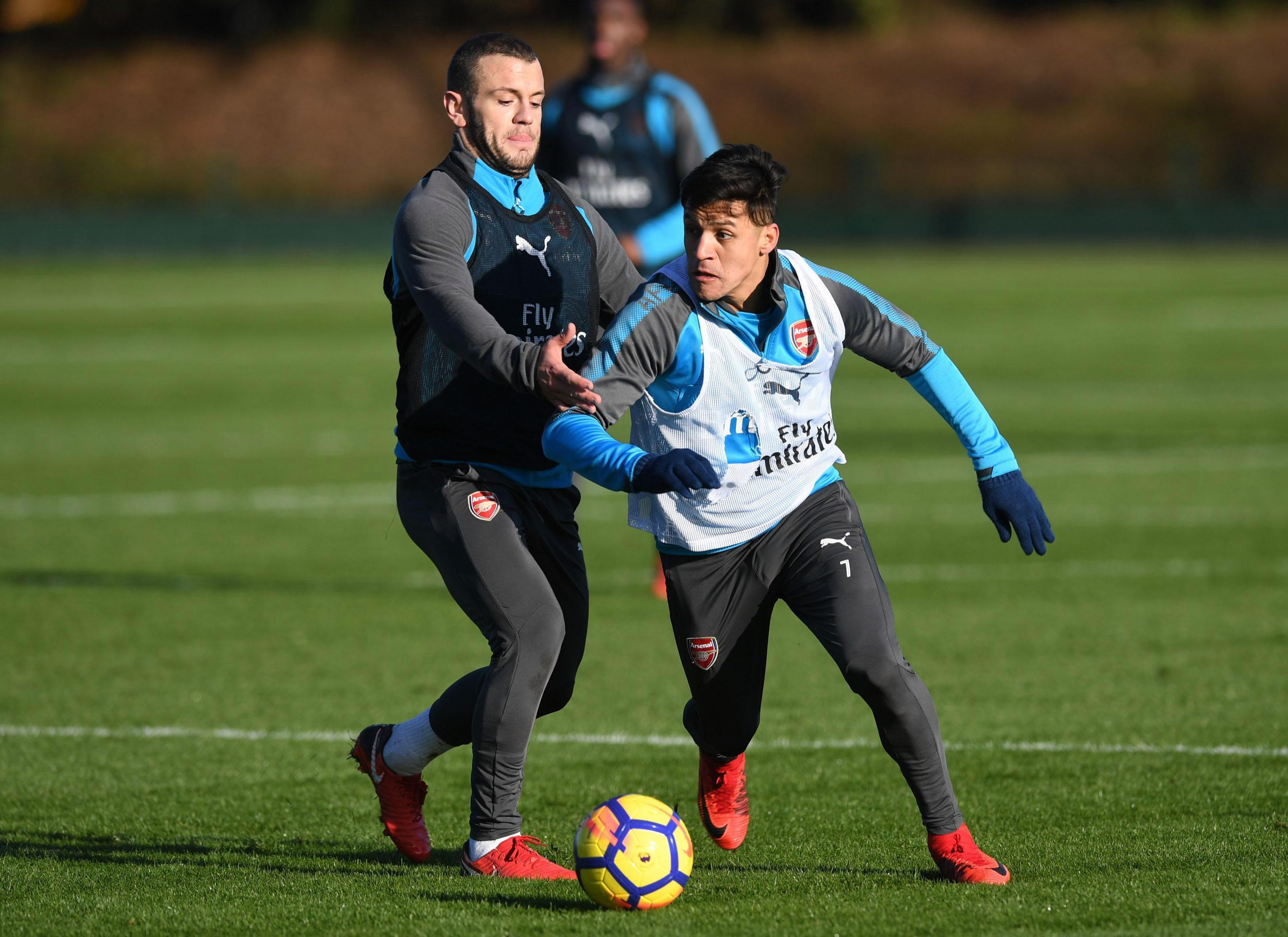 Sanchez with Jack Wilshere at training on Friday