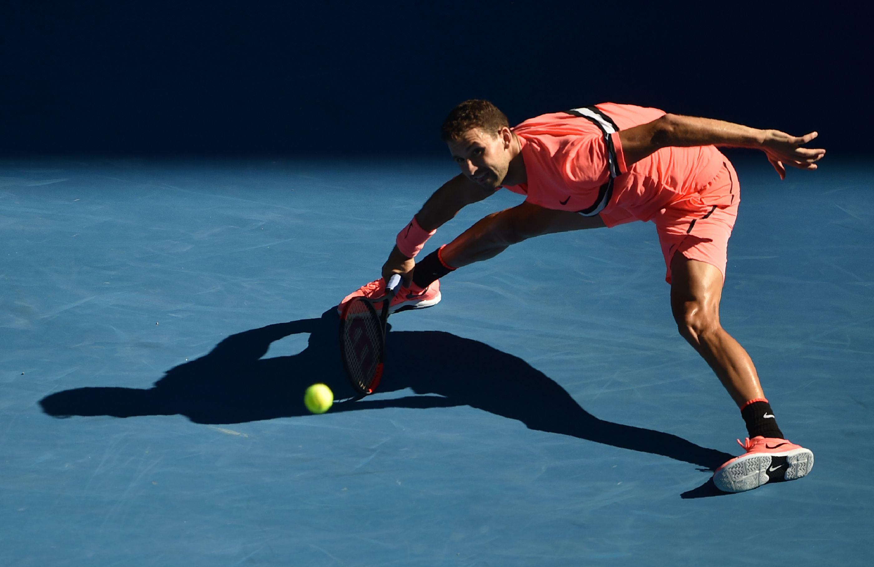 Grigor Dimitrov stretches in an attempt to make a shot at the Australian Open