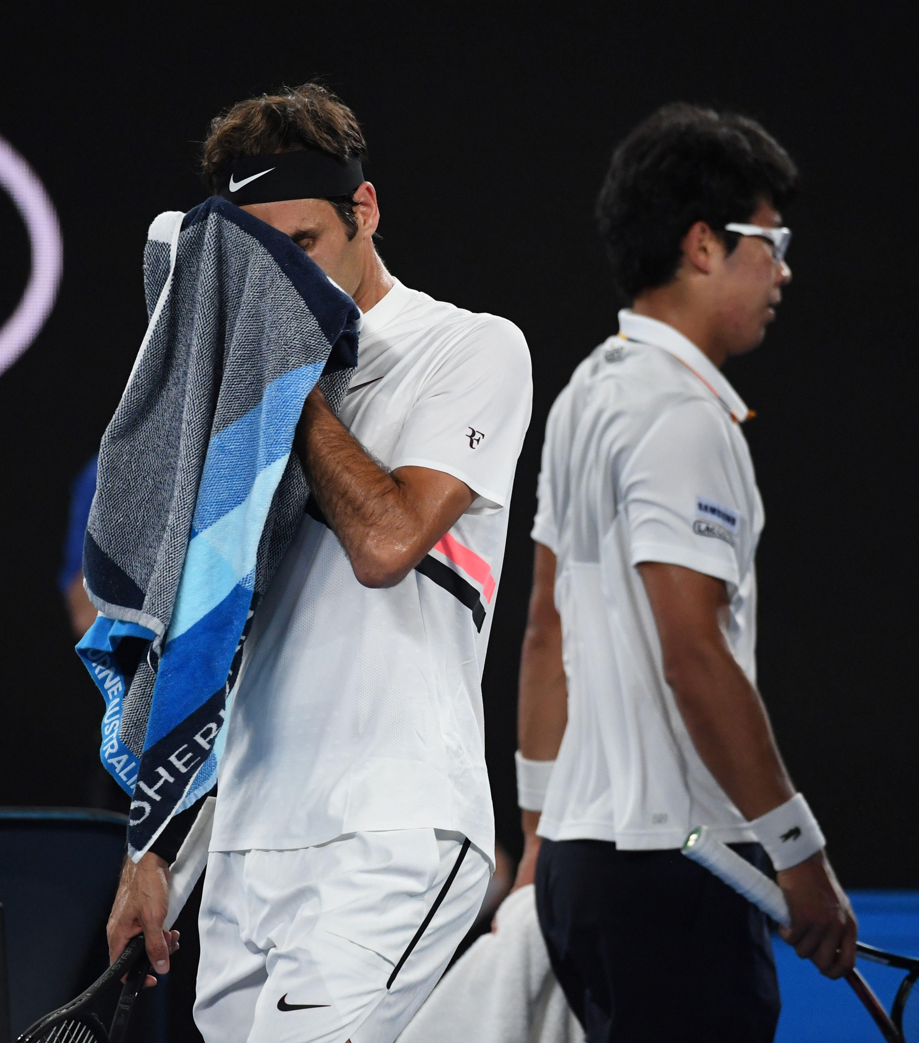 Roger Federer and Chung Hyeon during their semi-final clash in Australia