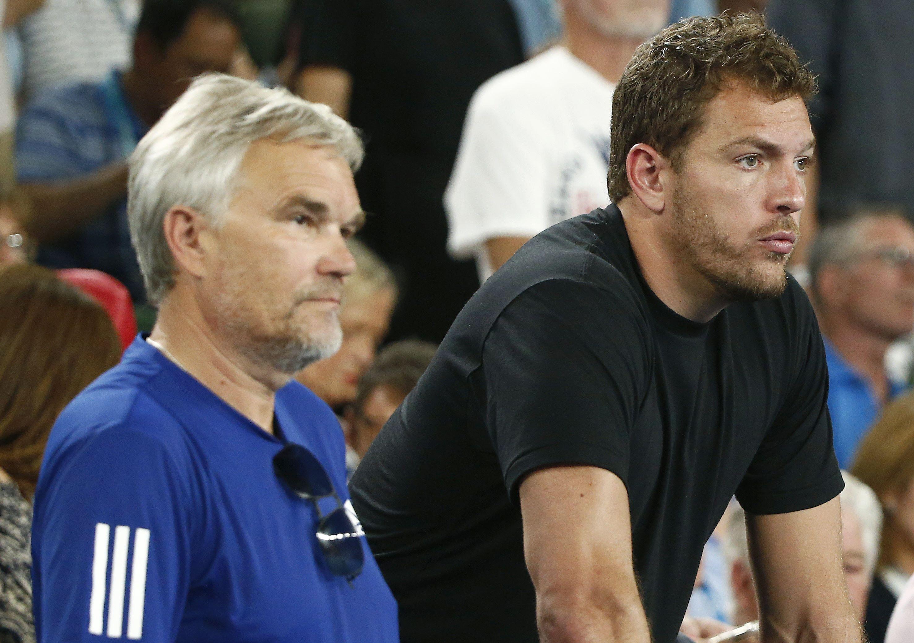 Piotr Wozniacki and the Dane's fiance David Lee watch on in Melbourne