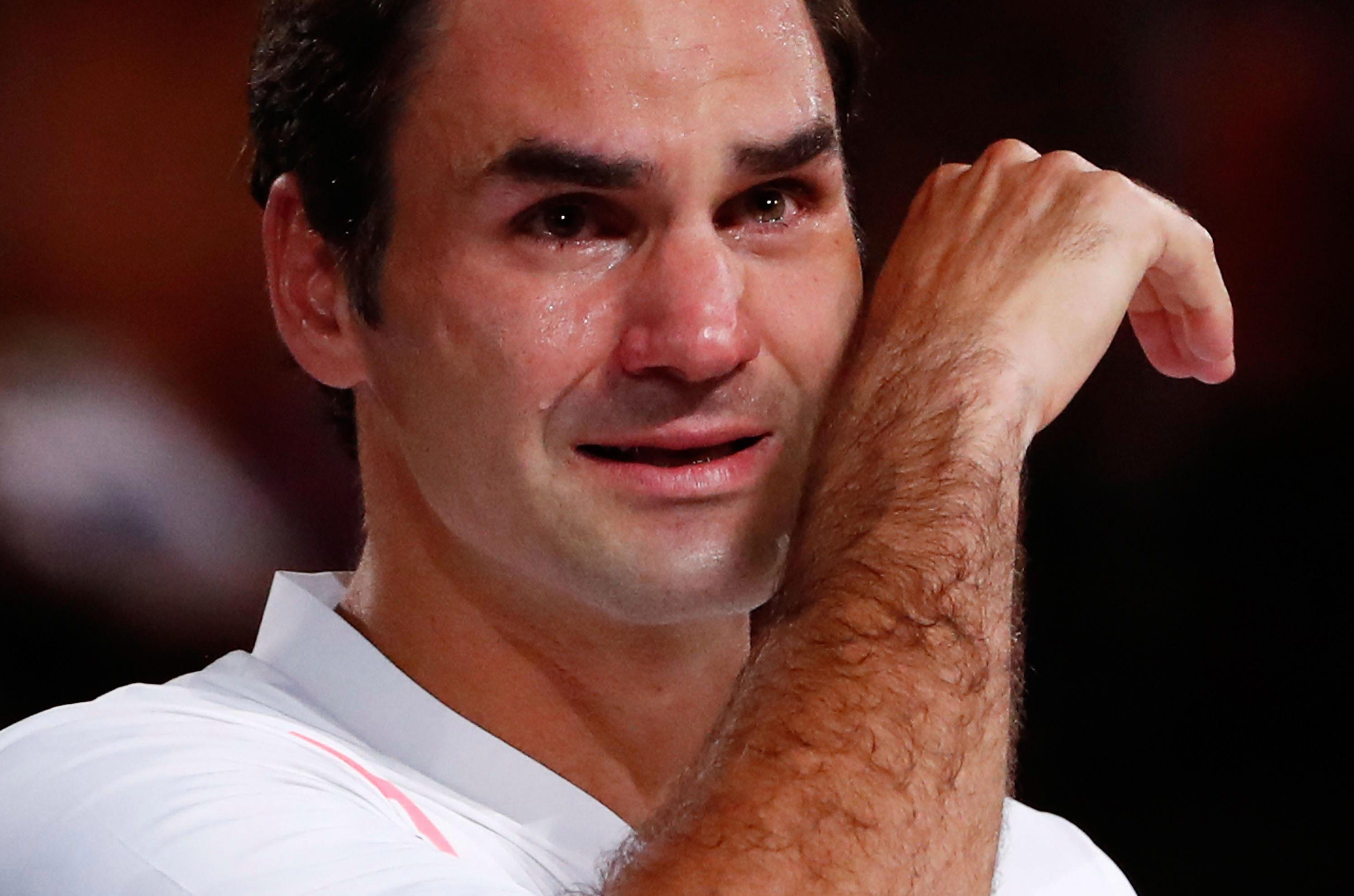 Federer was overcome with emotion after rewriting the history books with his sixth Australian Open title