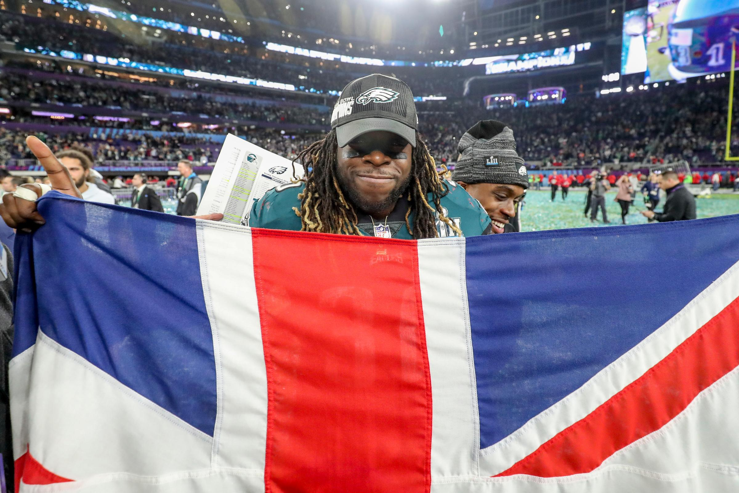 Jay Ajayi holds aloft a British flag after his Super Bowl win