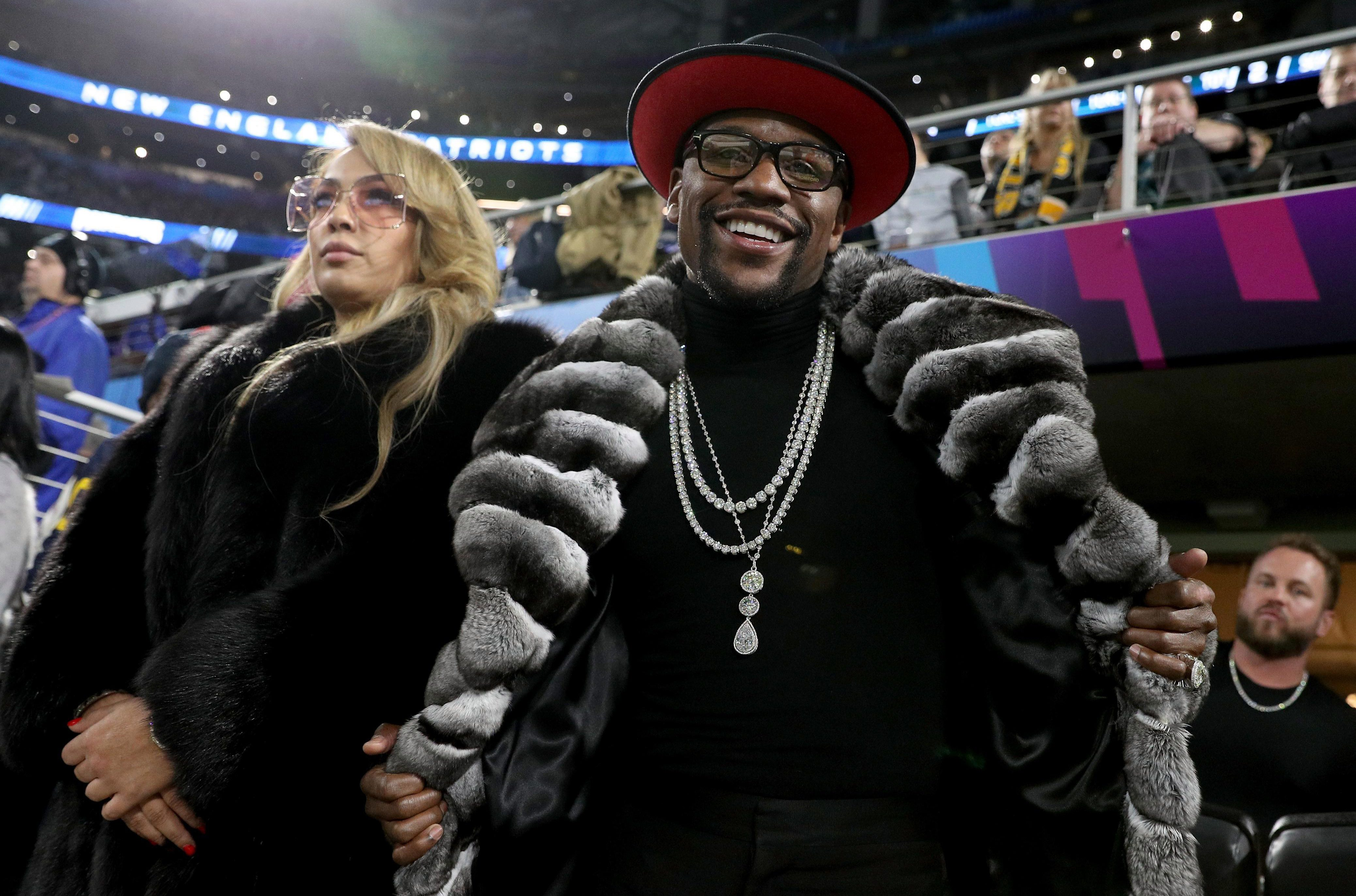 Floyd Mayweather rocked up at the Super Bowl in Minneapolis wearing a fur coat