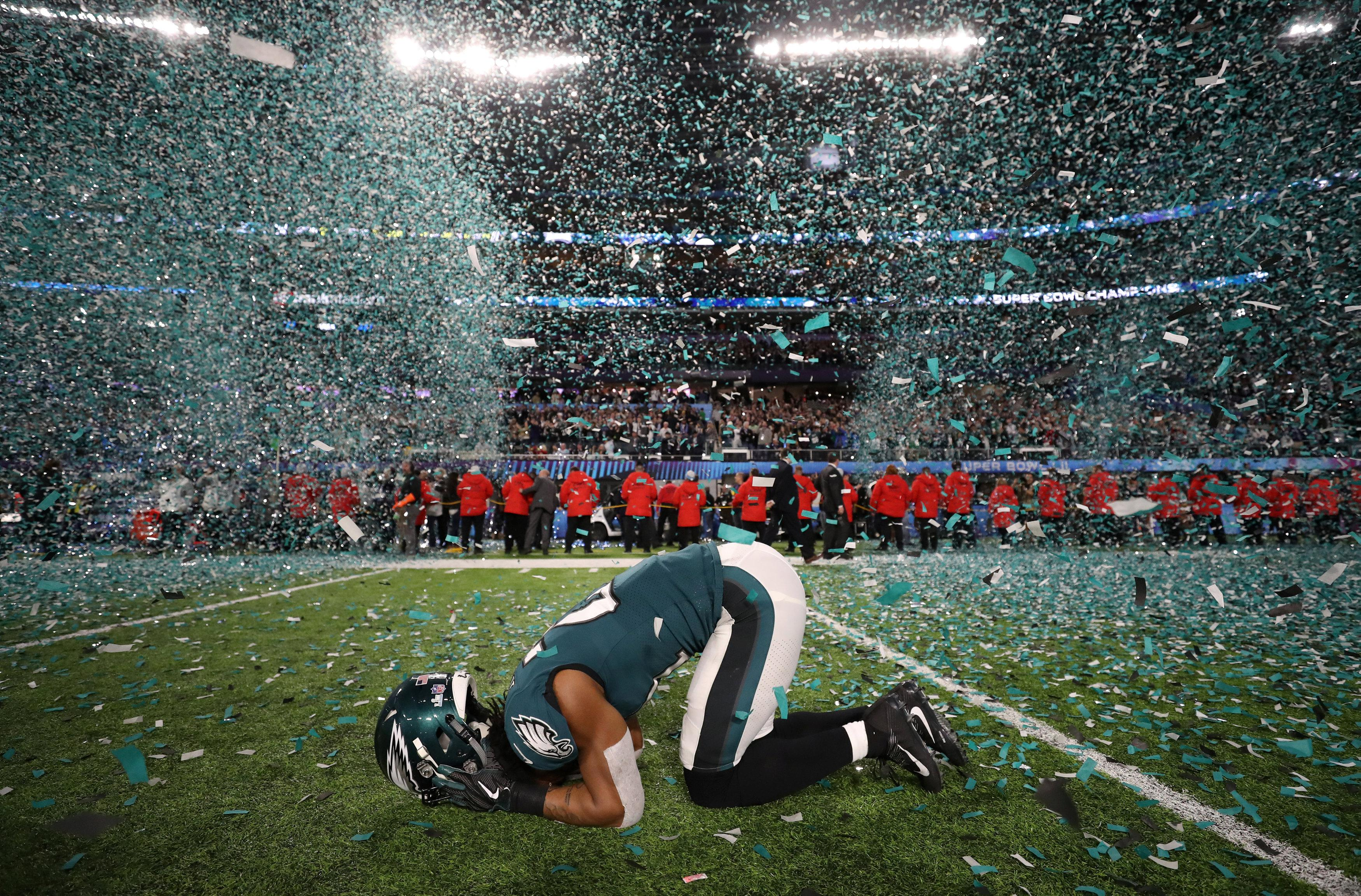 Eagles cornerback Patrick Robinson is overcome with emotion as he savours the Super Bowl win