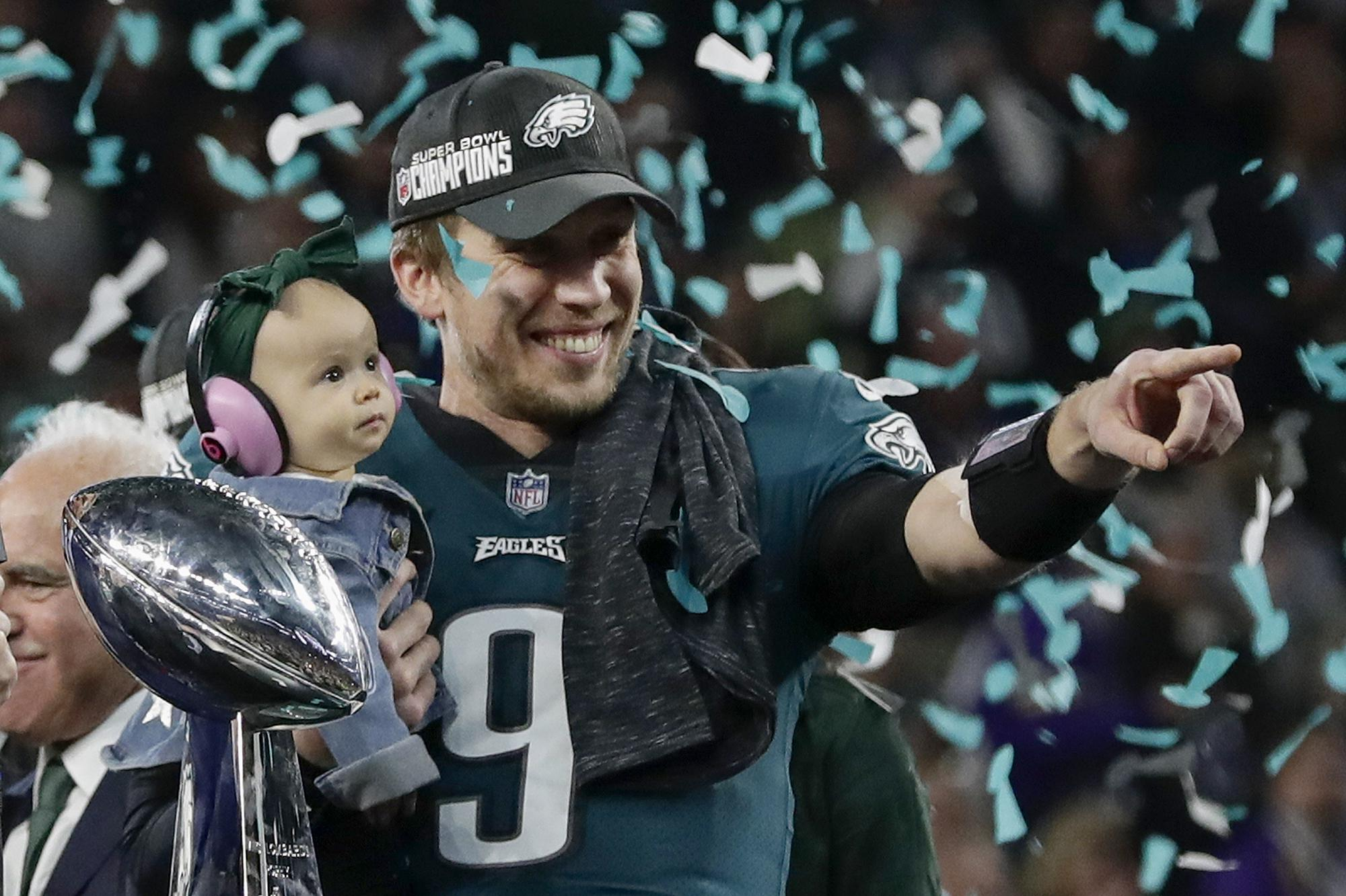 Nick Foles holds his daughter Lily after throwing Philadelphia to a stunning Super Bowl victory