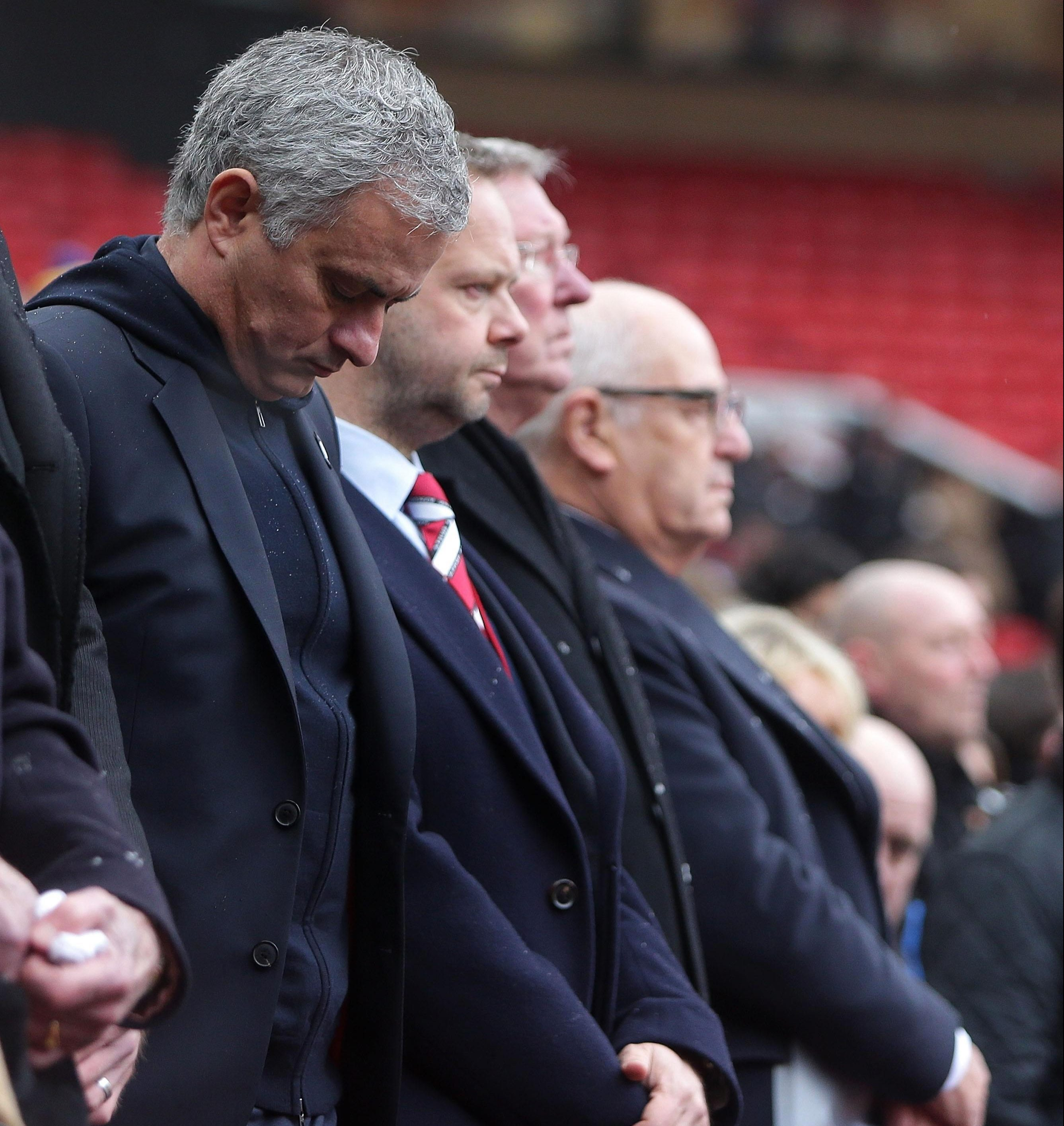 Jose Mourinho bows his head during an emotional service at Old Trafford
