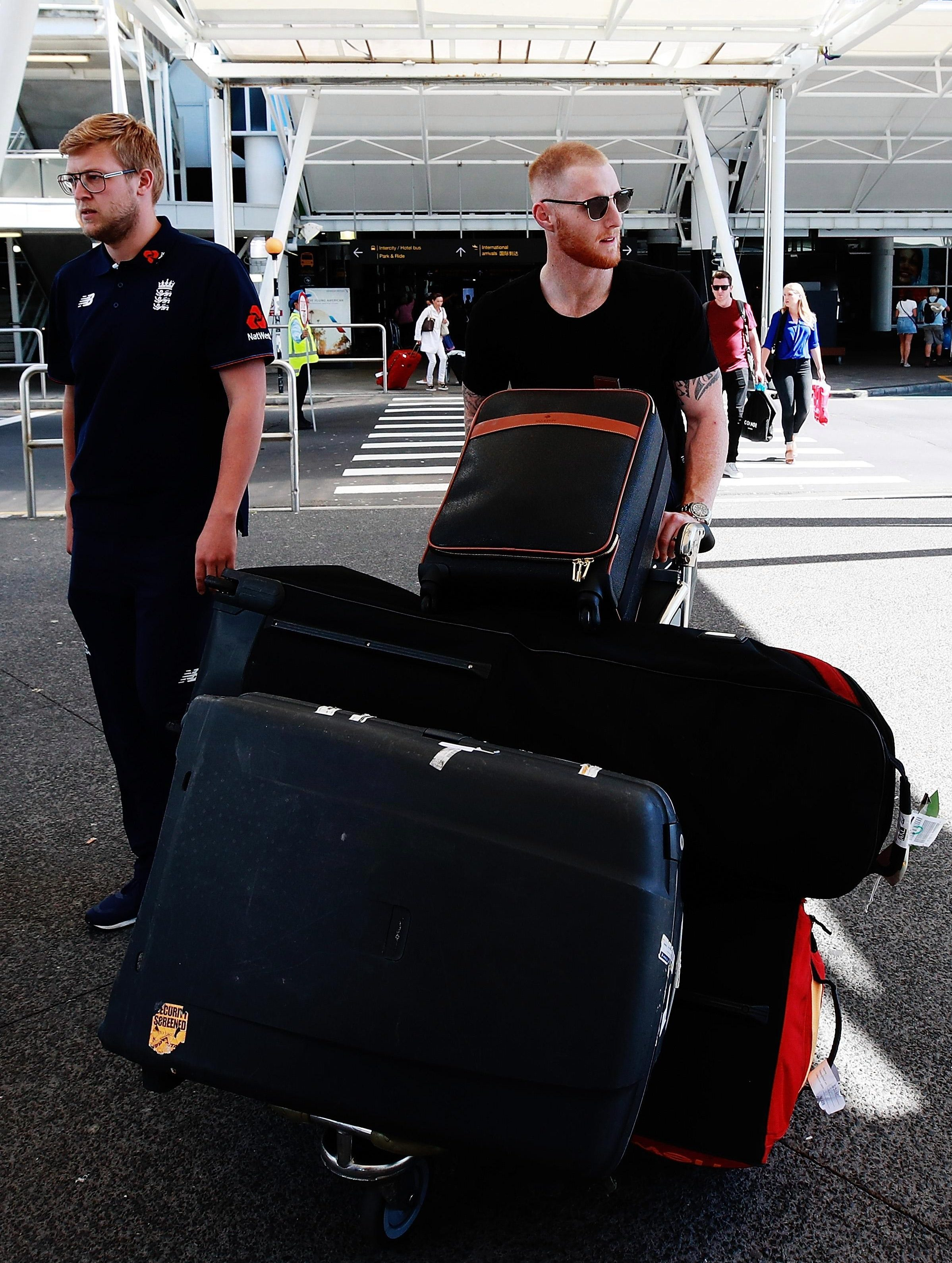 Stokes has a fairly hefty set of equipment with him as he wheels his equipment out of the airport terminal