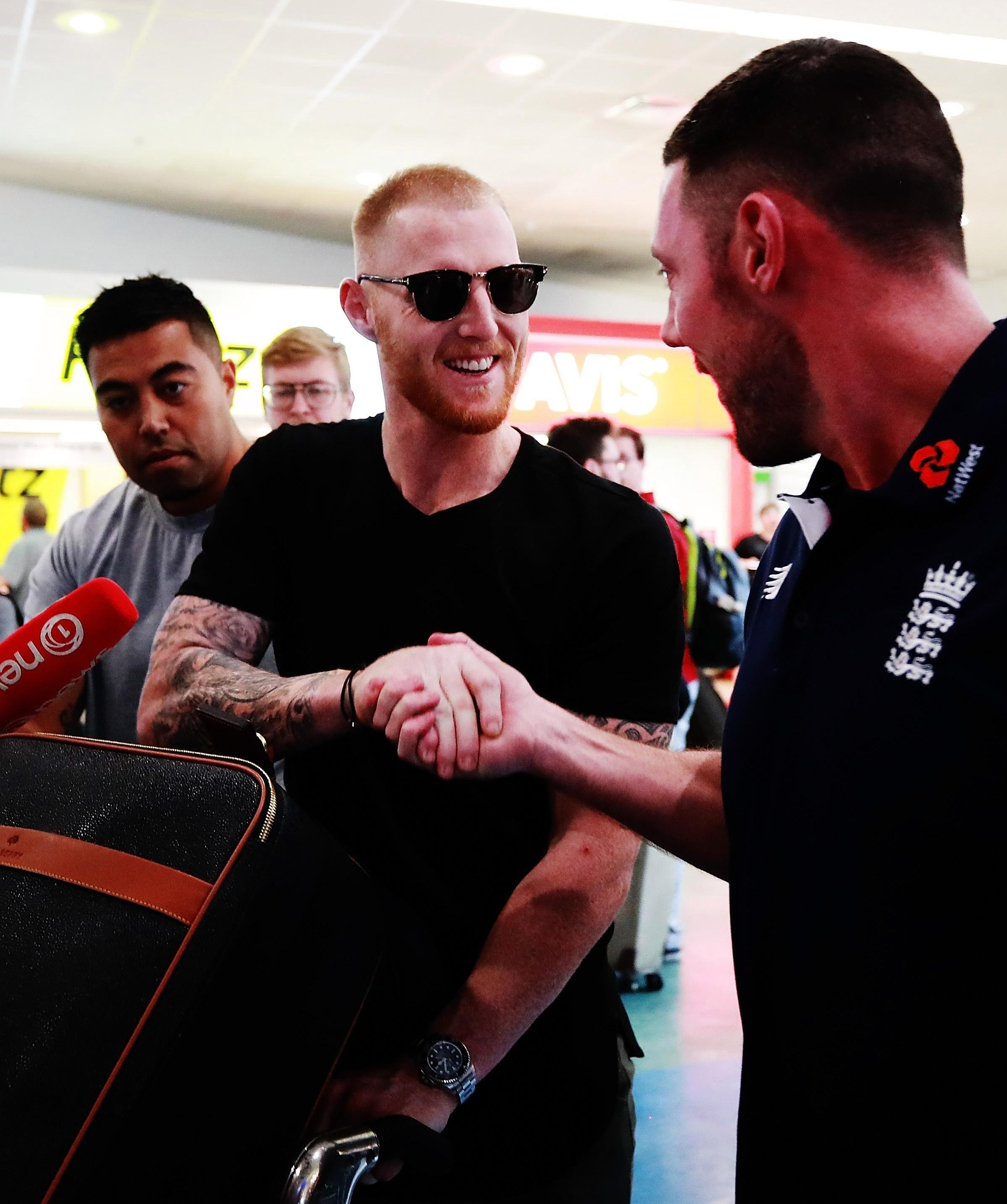 Ben Stokes shook hands with England staff members after landing in Auckland