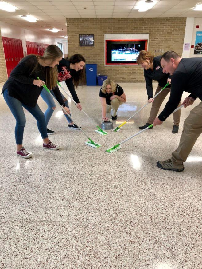 WHS staff perfect their curling technique after being inspired by Team GB