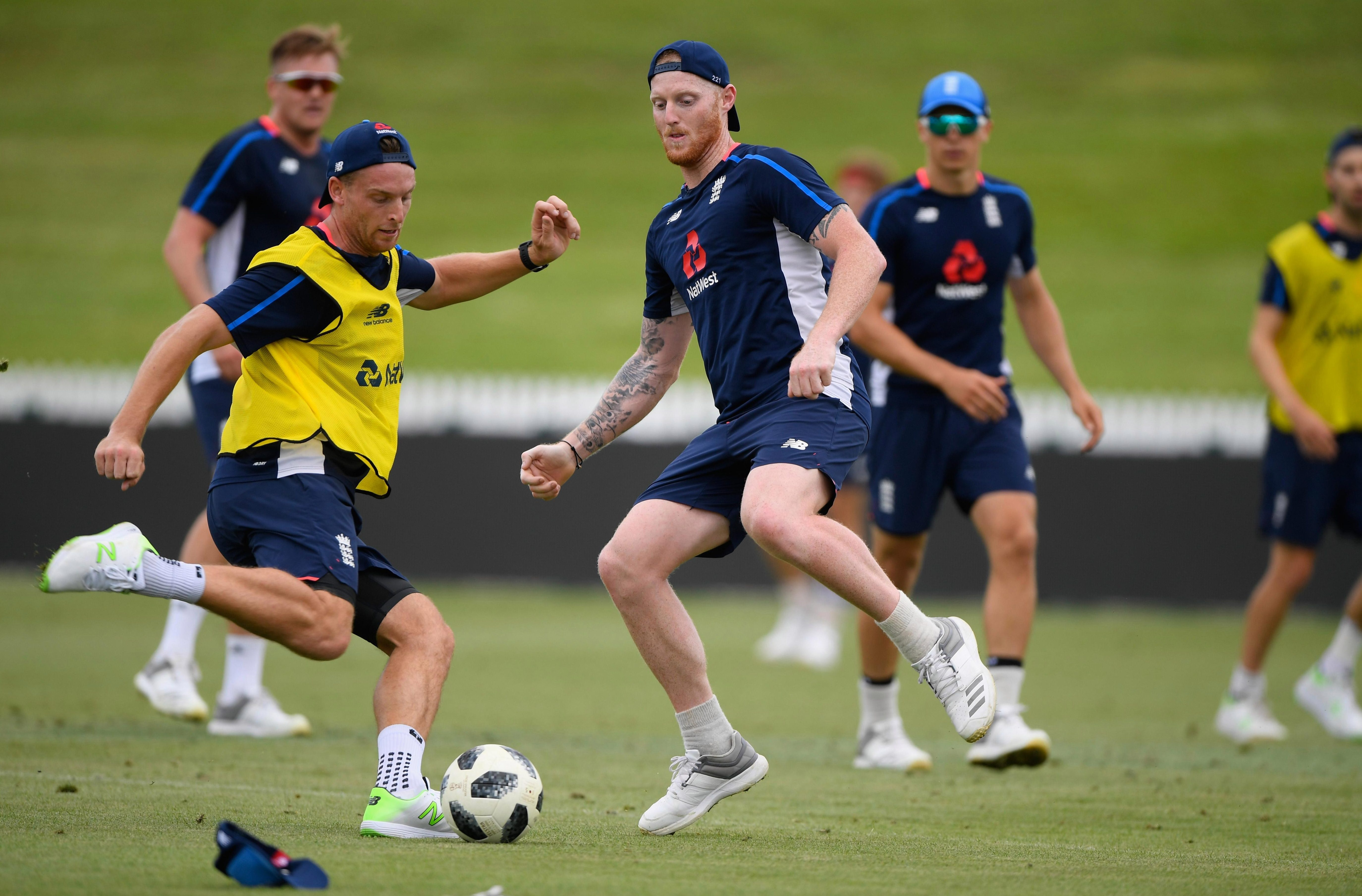 England's cricketers play a game of football in training