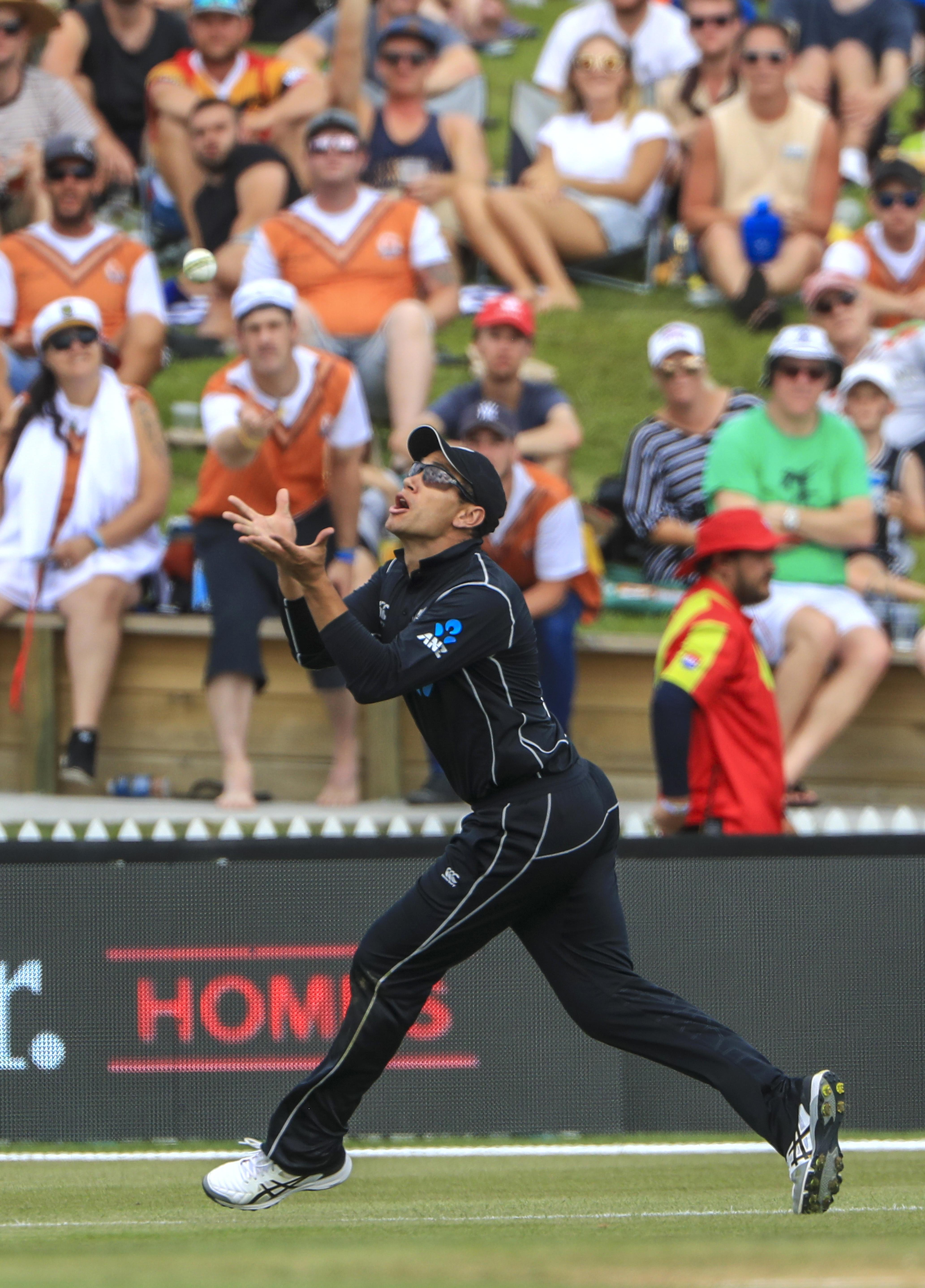 Ross Taylor keeps a close eye on the ball as he makes the catch from Ben Stokes' shot