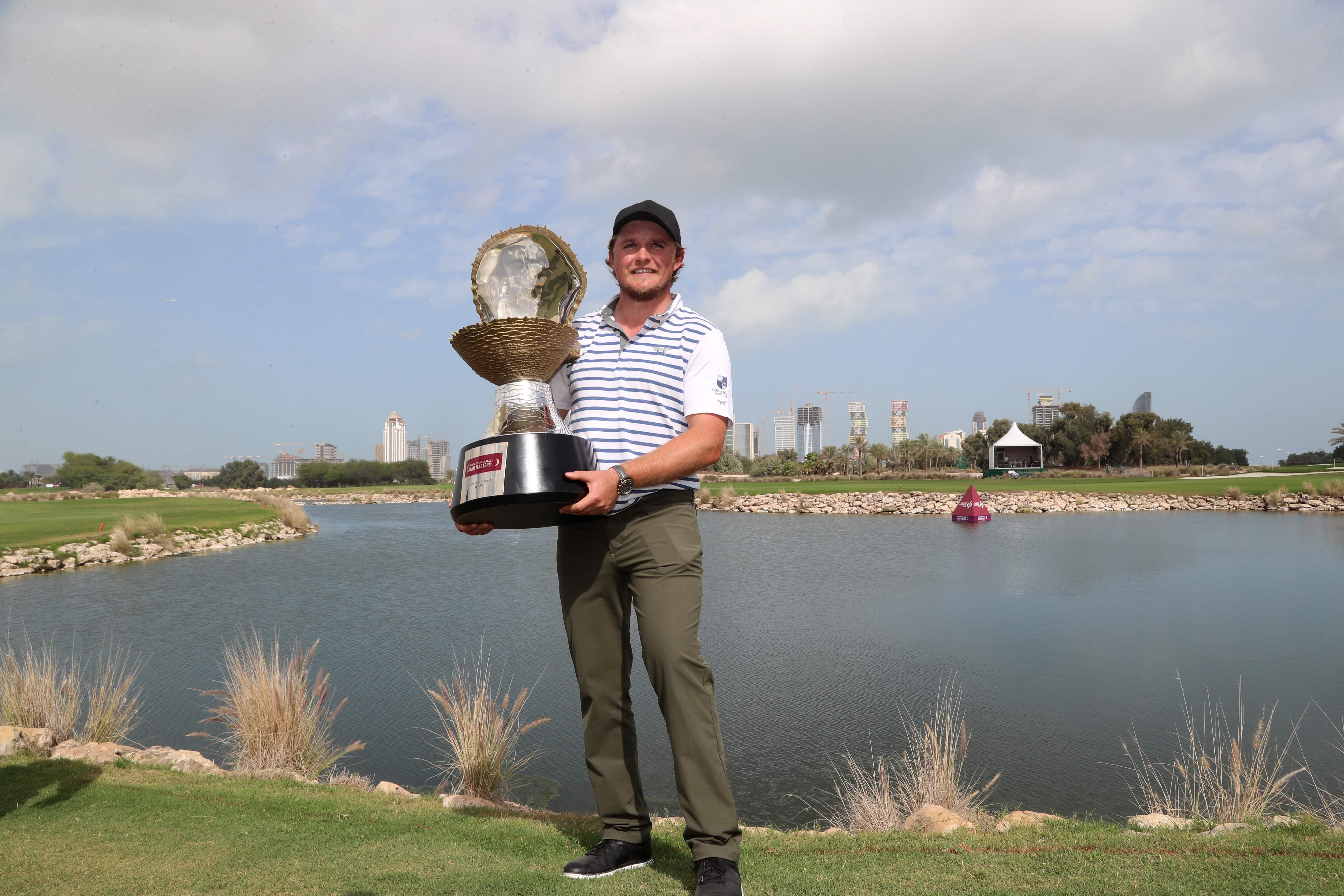 Eddie Pepperell lifts the trophy in Qatar