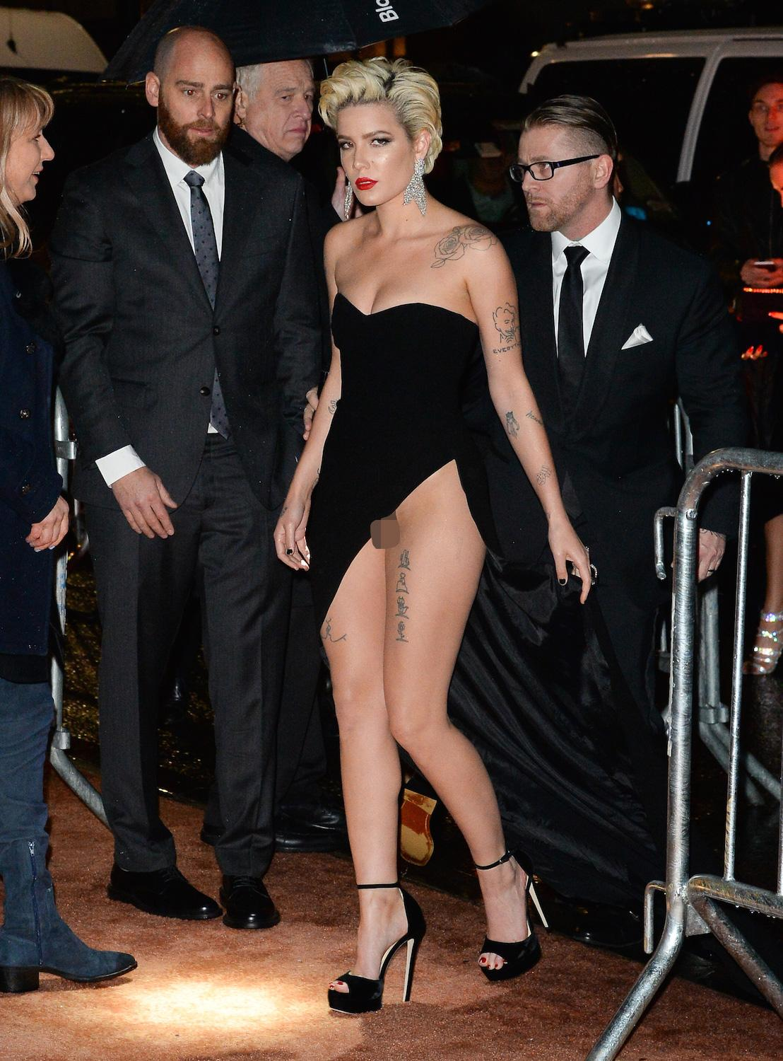 The star wore a revealing black strapless dress with thigh high split