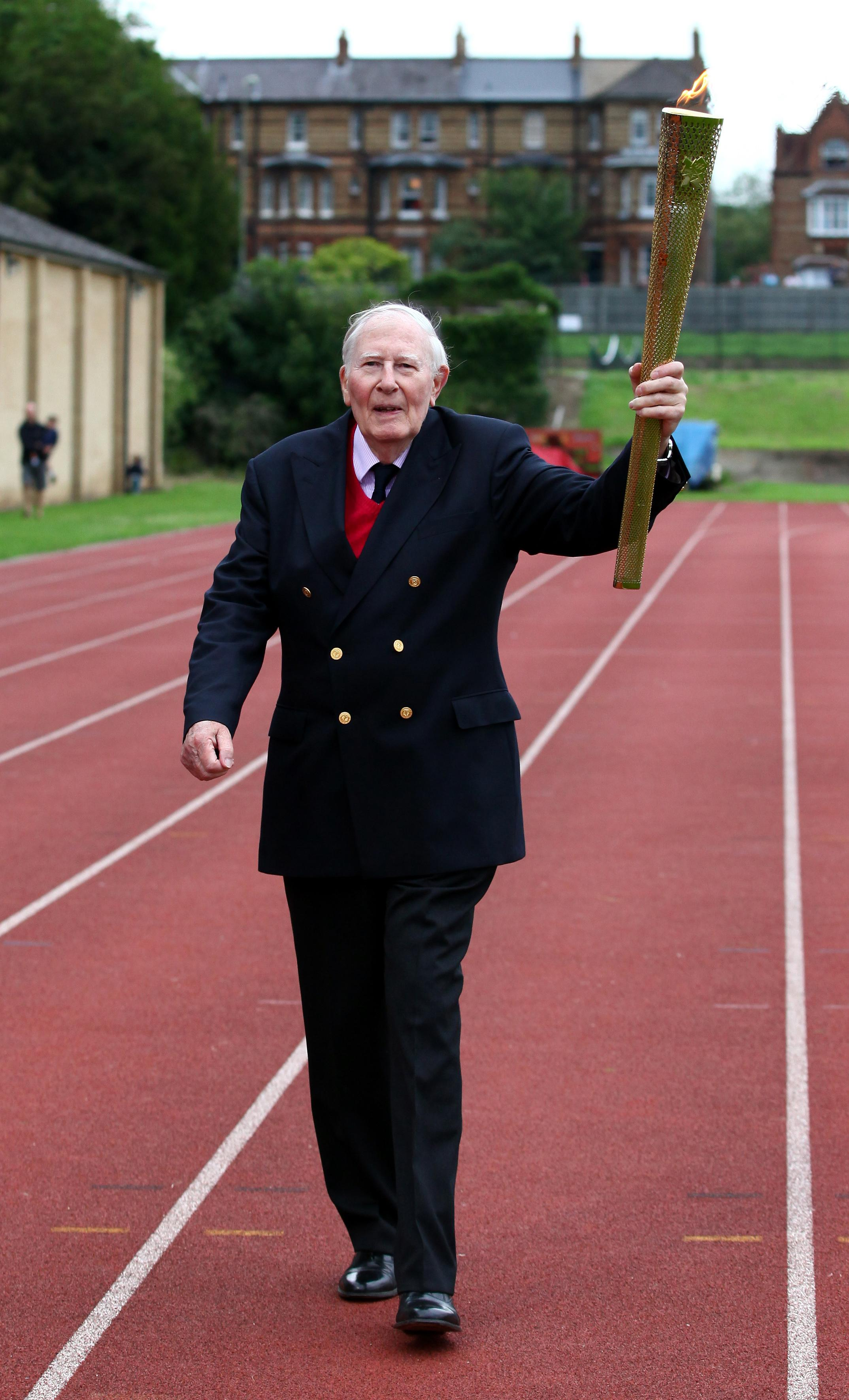 Sir Roger had a stint with the London Olympic flame on the running track at Iffley Road Stadium, Oxford where he broke the record