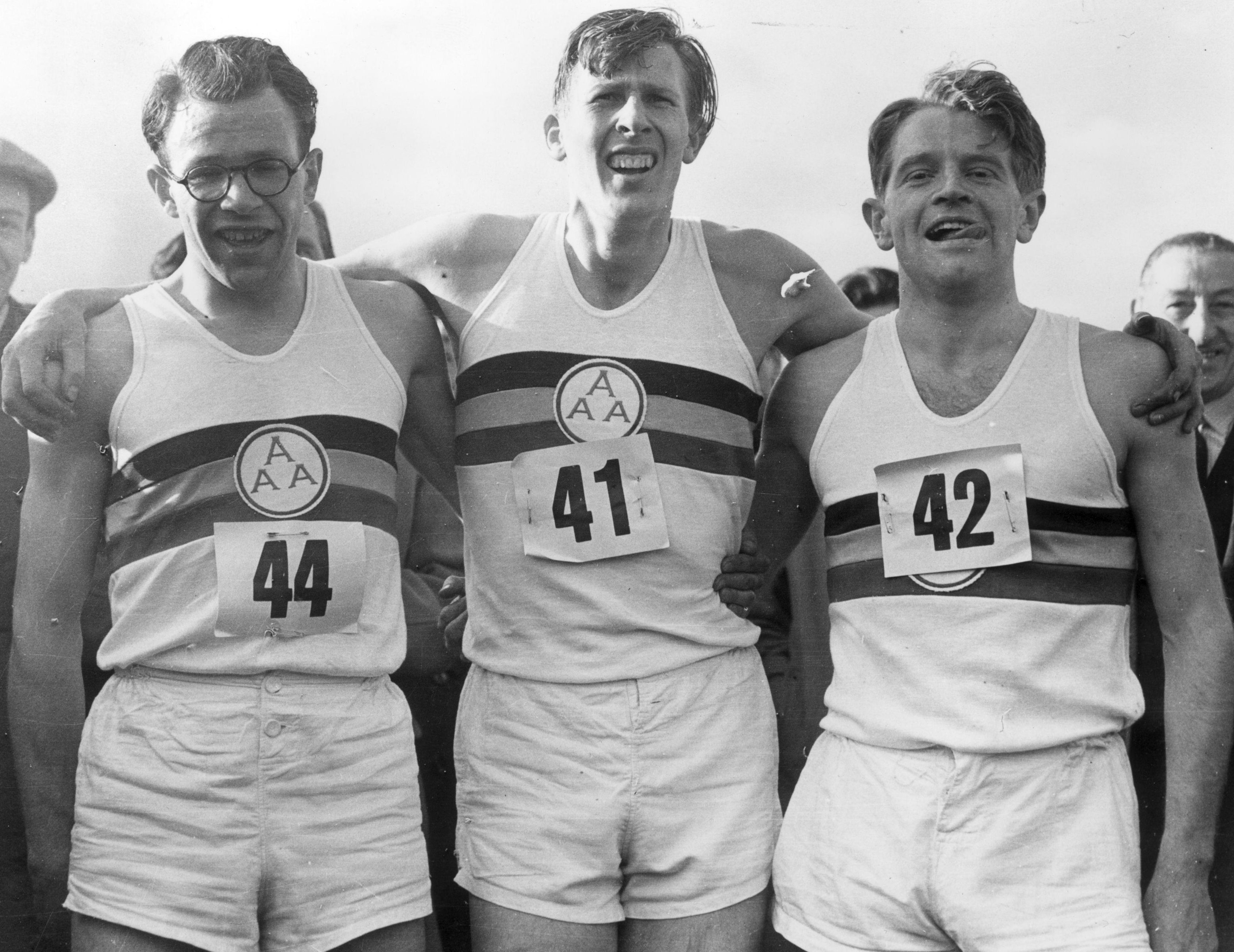 Bannister with pacesetters Chris Brasher left) and Chris Chataway