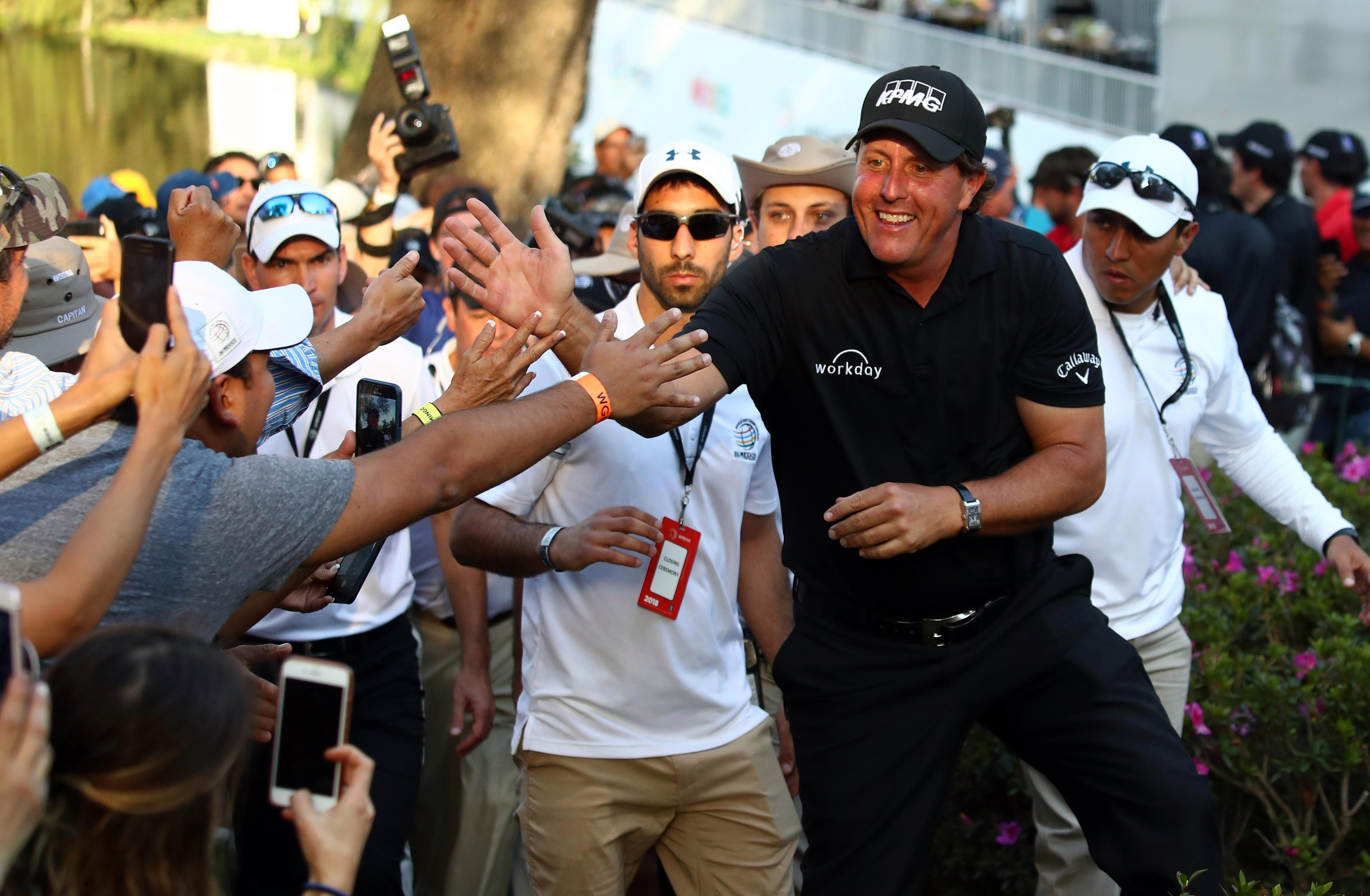 Phil Mickelson celebrates with fans after winning the title in Mexico City