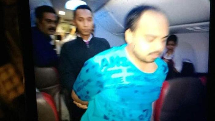 Air outrage... The man was then booted off the plane and arrested