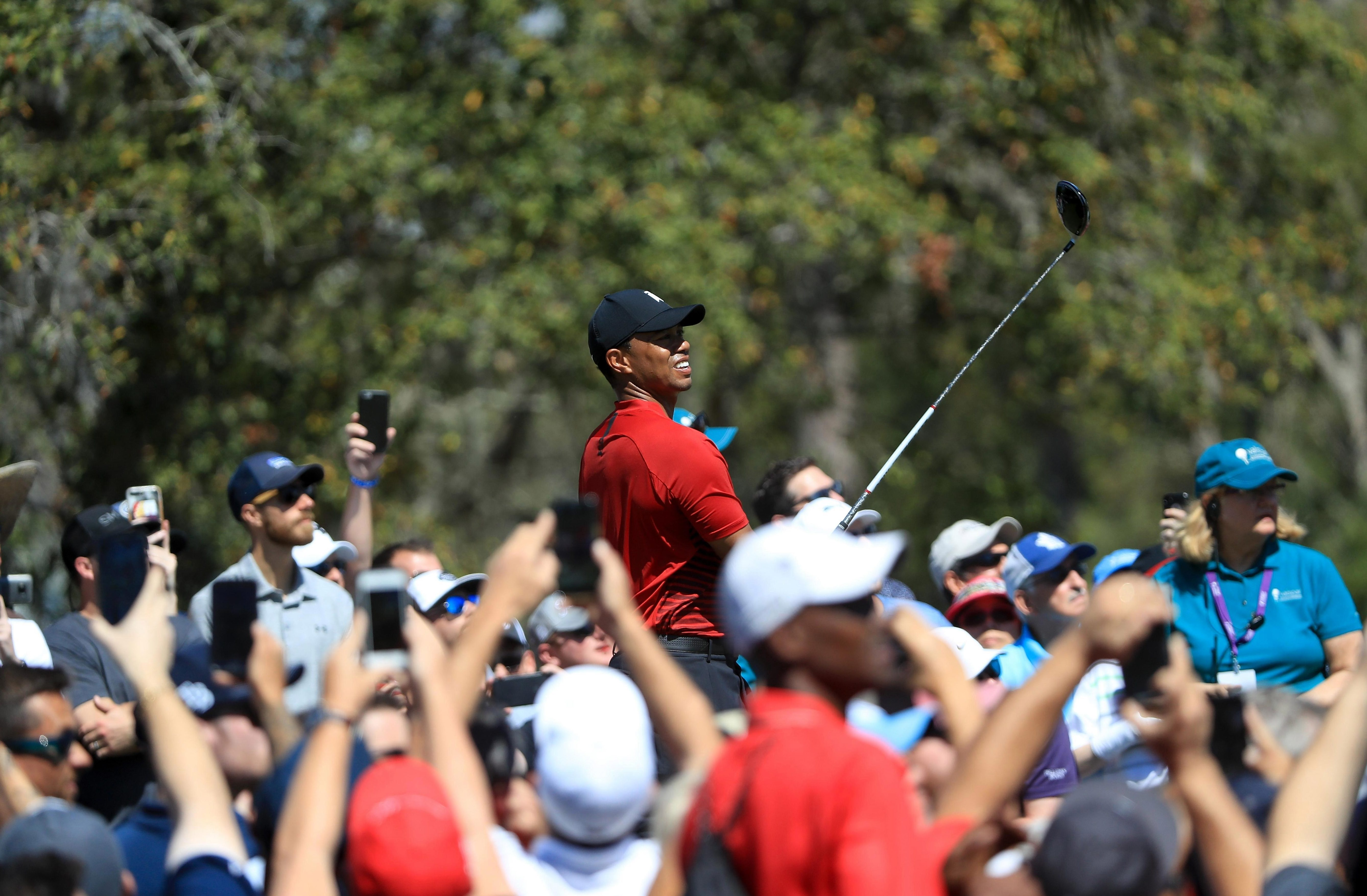 Tiger Woods was followed by a huge crowd as he went for victory